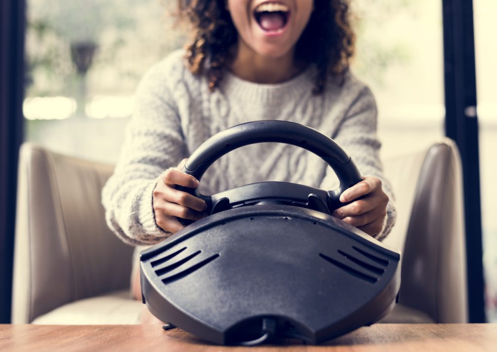 Woman playing a car racing vdo game